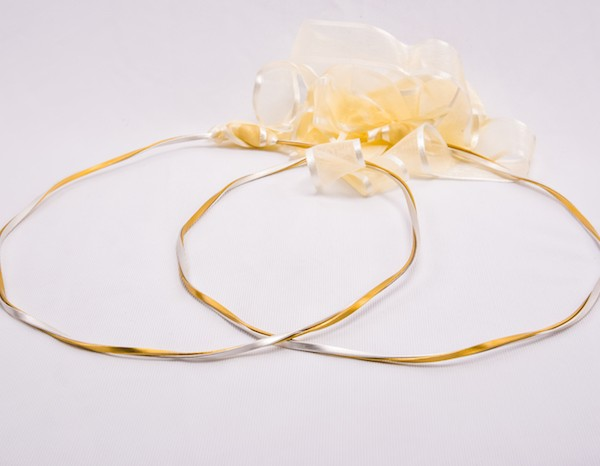 Handmade gold plated and sterling silver wedding crowns.