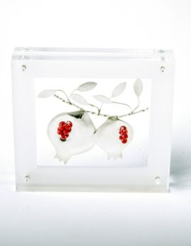 Handmade sterling silver pomegranates in plexiglass.